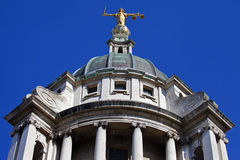 The Old Bailey in London. Looking up at the Lady Justice statue ontop of the Old Bailey in London Royalty Free Stock Photo