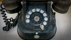 Old bakelite dial phone royalty free stock photo