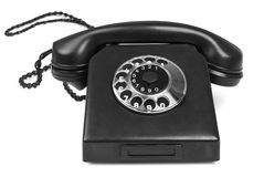 Old bakelite telephone. On white background, gentle natural shadow in front Royalty Free Stock Images
