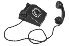 Old bakelite telephone. On white background, gentle natural shadow in front Stock Photo