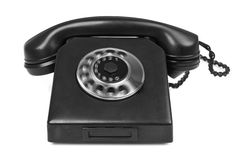 Old bakelite telephone with spining dial on white. Gentle natural shadow in front Stock Images