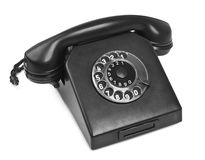 Old bakelite telephone on white. Natural shadow in front Royalty Free Stock Image