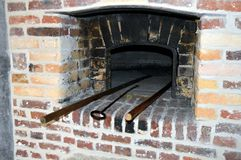 Old baker's oven. Old red brick-built baker's oven with a door in cast iron Royalty Free Stock Photos