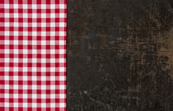 Old baking tray with a red checkered tablecloth Royalty Free Stock Images