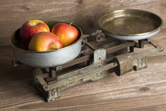 Old balance with apples Royalty Free Stock Images