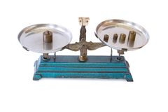 Old balance scale with weight brass isolated. On a white background stock image