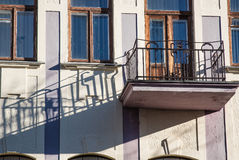 Old balconies. With long shadow Stock Images
