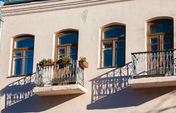 Old balconies. In sunny day Royalty Free Stock Images