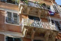 Balconies in arrow street in Corfu town Royalty Free Stock Photos