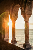 Old balcony with columns. In Portovenere at sunset, Italy stock images