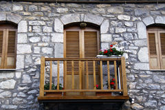 OLD BALCONY WITH FLOWERS. IN GREECE Royalty Free Stock Images