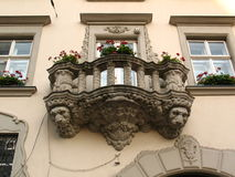 Old balcony with the heads of lions Stock Photo