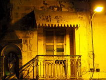 Old balcony in marsaxlokk at night Royalty Free Stock Photo