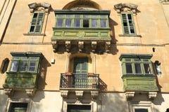 Old balcony in Valletta, Malta. Old balcony details on historical building in Valletta, Malta Stock Image