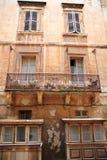 Old balcony  in Valletta, Malta. Old balcony details on historical building in Valletta, Malta Stock Images