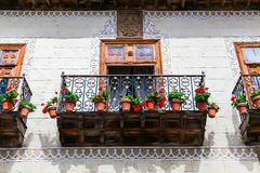 Old balcony wth flower pots Royalty Free Stock Image