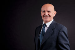Old bald businessman Stock Photography