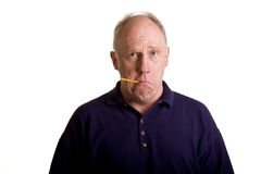 Old Bald Guy with Thermometer in Mouth Royalty Free Stock Photos