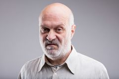 Old bald man disgusted and disappointed. That`s not good at all says this old bald man disgusted and disappointed Stock Image