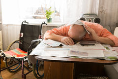 Old Bald Man Napping on the Table with Newspapers Royalty Free Stock Images