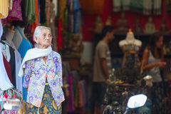 Old balinese woman near souvenir shop in Ubud Royalty Free Stock Images