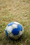 An old ball. An old football on the ground Stock Photo