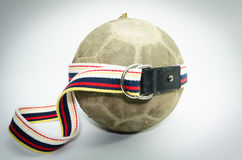 Old ball with fabric belt isolate on white background Royalty Free Stock Photography