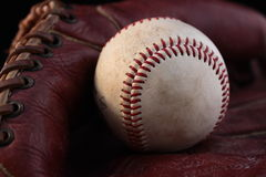 Old ball and glove Royalty Free Stock Photos