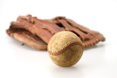 Old Ball and Glove. Old baseball and fielders mitt baseball in focas Stock Photo