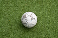 Old ball on the grass Stock Photos