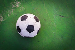 Old ball on the green cement. top view Stock Images