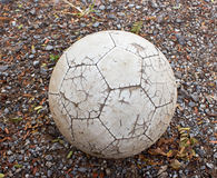 Old ball on the ground Royalty Free Stock Photo