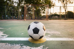 Old ball at kick off point in court Royalty Free Stock Photos