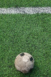 Old ball on new ground Stock Photo