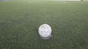 Old ball on new ground Royalty Free Stock Photography