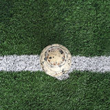 Old ball on new ground Stock Images