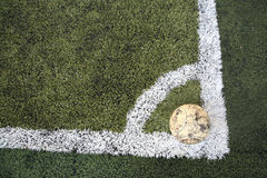 Old ball on new soccer ground Royalty Free Stock Photo