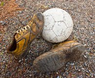 A old ball and old shoes Royalty Free Stock Photo