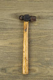 Old Ball Peen Hammer on Faded Wood Stock Images