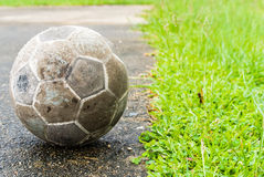 Old ball. Put on football field and grass Stock Image