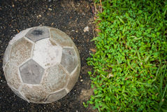 Old ball. Put on football field and grass process vintage style Stock Photography