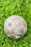 Old ball. Put on green grass Stock Photo