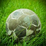 Old ball put on green grass Royalty Free Stock Photography