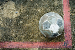 Old ball put no conner. In football field Royalty Free Stock Photos