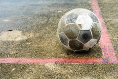 Old ball put no conner. In football field Stock Image