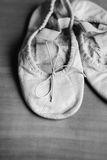 Old ballet shoes. A worn out pair of children's ballet shoes royalty free stock images
