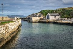 Old Ballintoy Harbor. This is the picture of Ballintoy harbor on the Antrim Coast in Northern Ireland. This it the film location for the Game of Thrones royalty free stock image