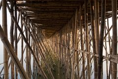 Old bamboo bridge across Mekong in Kampong Cham. View under the old traditional bamboo wooden bridge across Mekong river, Kampong Cham, Cambodia Stock Image