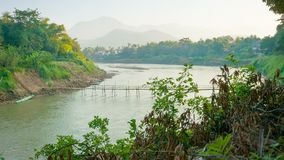 Old bamboo bridge across the river. Laos, Luang Prabang stock video footage