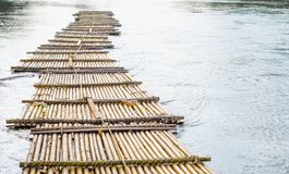 Old bamboo raft is floating on the river in the thailand Stock Images